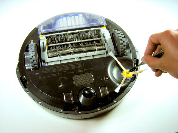 With the Roomba upside down and turned off, use the Phillip's 02 screwdriver to remove the one 3.5 mm screw from the center of the side-brush.