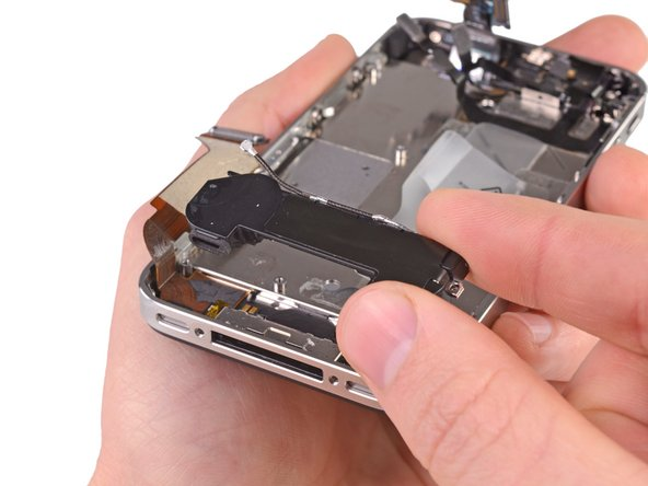 Remove the speaker enclosure assembly from the iPhone.