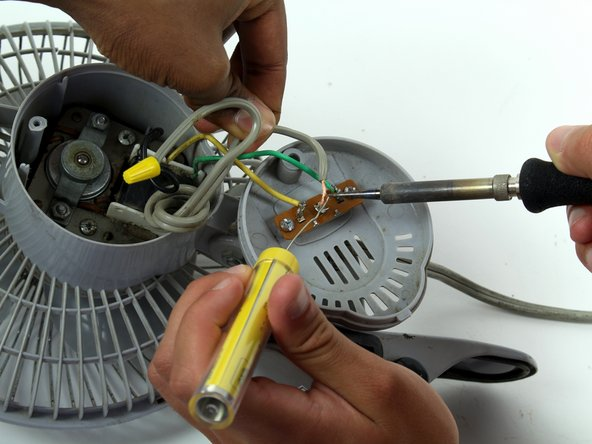 After replacing the switch, resolder the gray power cord, the green wire, and the yellow wire.