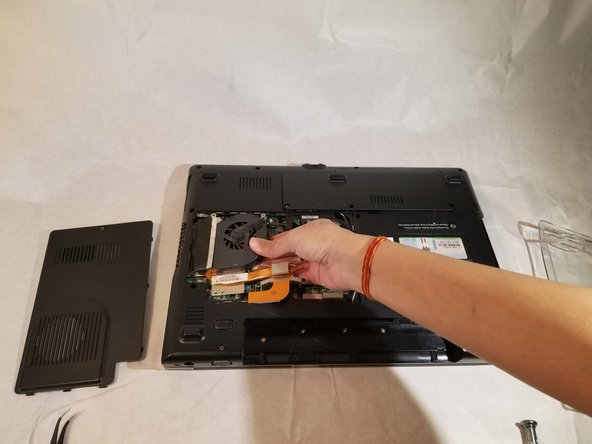 Remove the fan by moving it to the side and lifting it out of the computer.