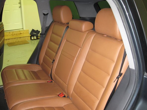 Image 1/3: Flip the bottom of the seats forward.  Remove the headrests, and lay the seat-backs down flat.