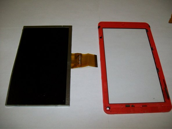 Use plastic opening tools to push back clips along the side of the device removing the screen
