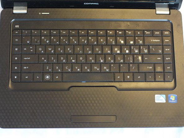 Open up the front of the laptop. Use a plastic opening tool to carefully pry open the keyboard from the edges.