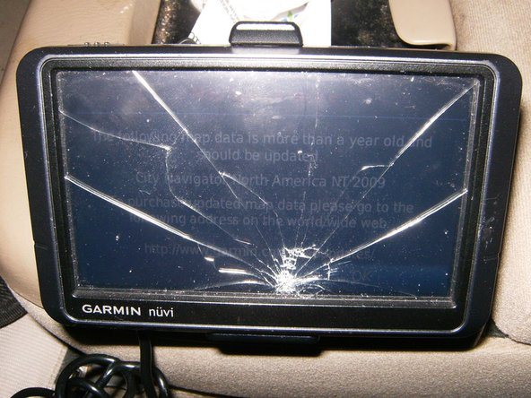 The cracked screen is clearly visible. LCD is still functioning, but obviously no touch function.