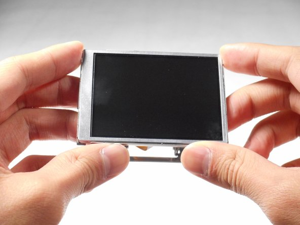 Image 2/2: Remove the LCD screen from the screen cover.