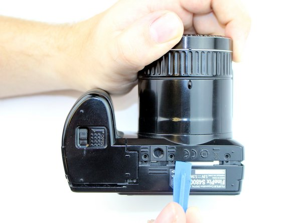 The plastic case is fragile, so take your time on each side making sure to pry each side evenly as you continue around the camera with the tool.