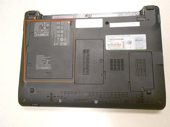 The hard drive is located on the bottom of the laptop on the left hand side.