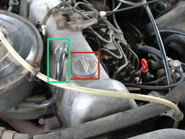 Inspect the area on the valve cover around the oil cap for oil leaks.