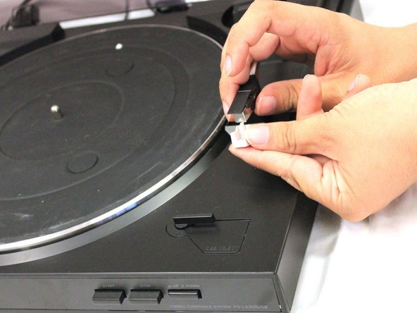 Pull the cartridge down and towards you to remove it.