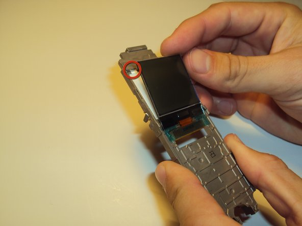 To remove LCD screen pry back on highlighted clip and pull screen out. The screen will then pull up and out.