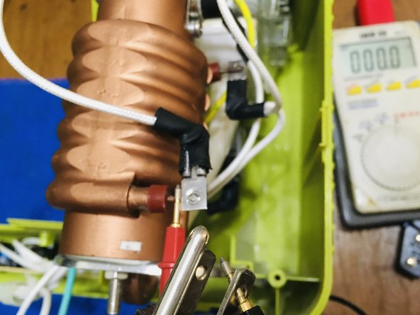 """Check if the fuse is brown with multimeter. There should be zero resistance between """"Neutral"""" on the plug and the lower connector of the water heater. (This photo is actually taken after replacement, so the reading is zero.)"""