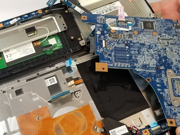 Once all of your connections have been removed, grasp the motherboard by the corners and gently lift it from the laptop. It should come out easily.