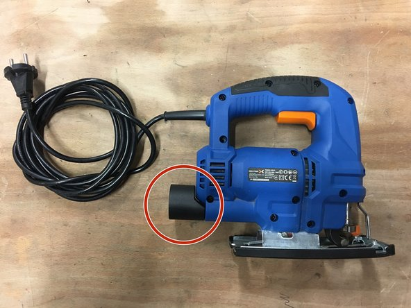 Remove the vacuum hose adapter at the back of the device.