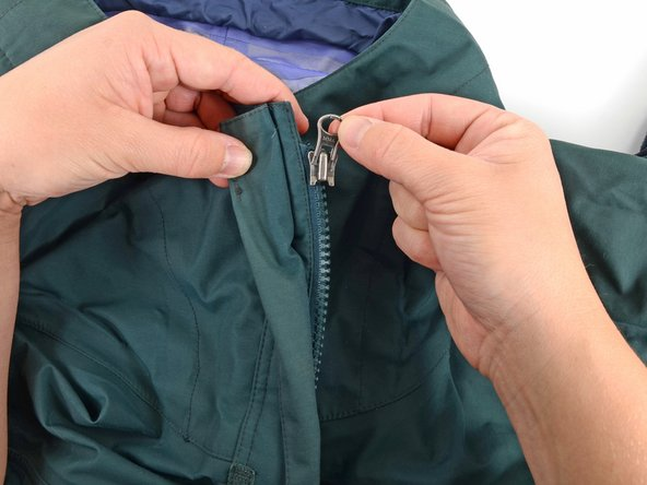 Slide the slider off of the garment.