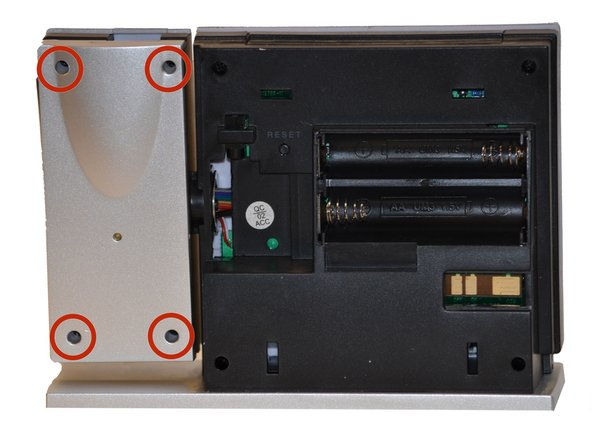 Use a Phillips #00 Screwdriver to remove the four (4) screws from the back of the projection arm.