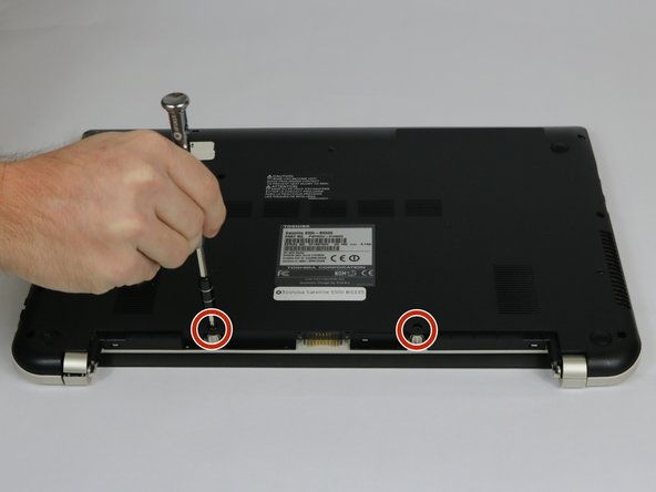 Remove the two 7 mm Phillips #1 screws that hold the battery in place.