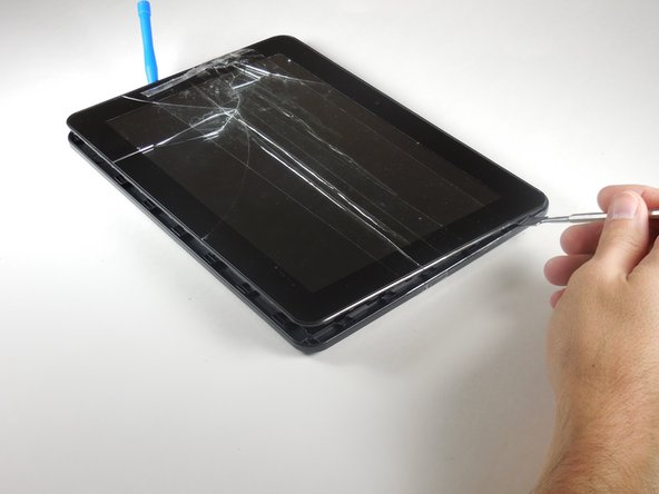Slide the metal spudger around the casing to separate it from the inside of the tablet.