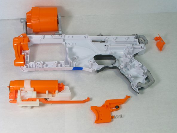 Lift the Nerf dart cylinder and the firing mechanism (spring chamber).