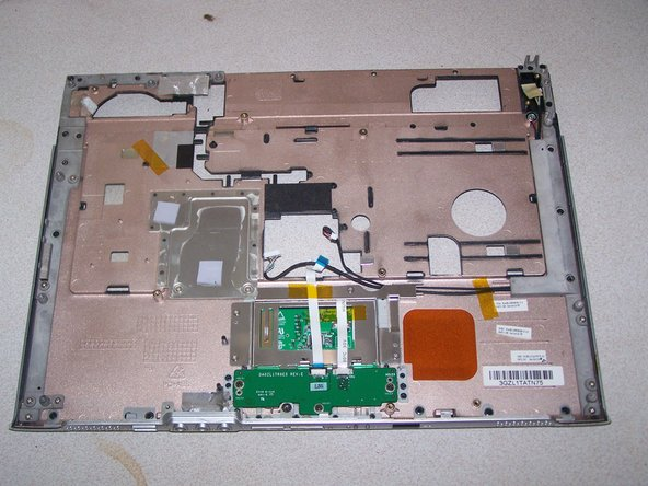 Your laptop should now look like this; middle photo is the remaining logicboard and bottom case, the last photo is the topcase cover.