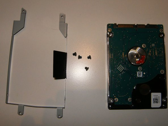 The hard drive is now removed from the caddy and the replacement can be installed.