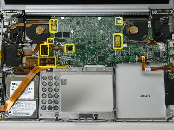 Image 1/1: There should be no cables connected to the top of the logic board at this point.