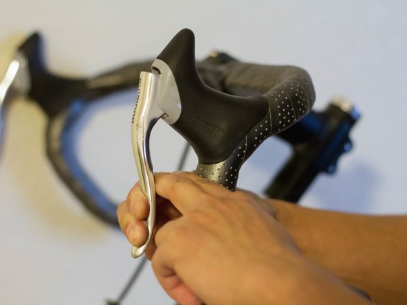 Check if the brakes are working properly by squeezing your brake levers.