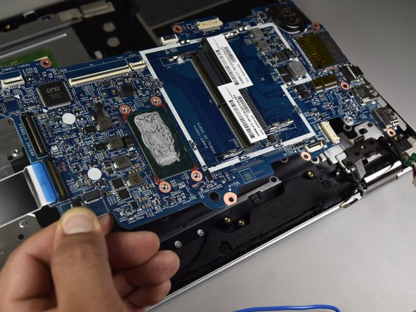 Using your hand, gently lift up the motherboard to remove it.