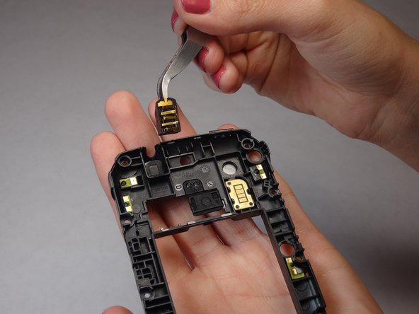 The Headphone Jack is attached with adhesive, remove carefully.