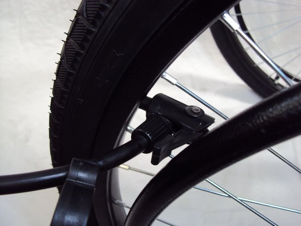 Inflate the tire to 50 psi. If there is no gauge, inflate the tire until the tire is hard.