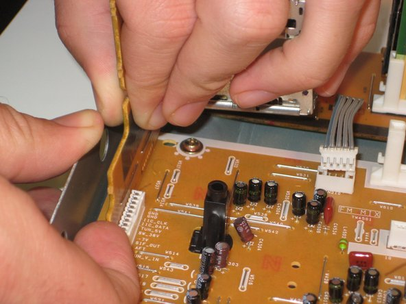 First unsnap it from the tab that holds it to the mother board (see image two).