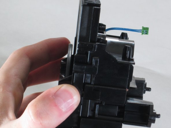 Image 1/3: Pull down firmly and away from the laser housing.