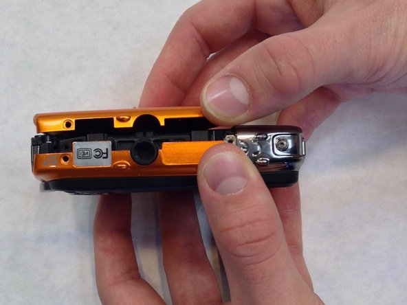 Using a Phillips #00 screwdriver, remove two 3.0 mm screws on the bottom of the front face.