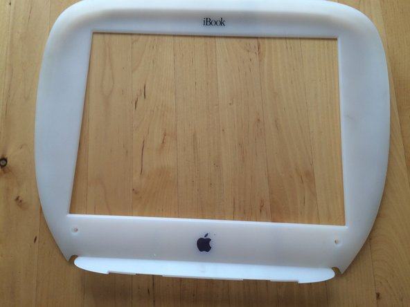 Image 2/2: When at the top rubberized area, pry the bezel down.