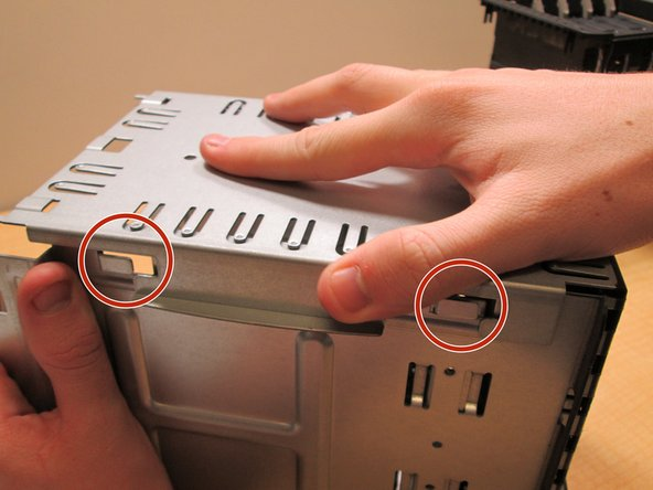 Now slide the metal pieces away from each other to move past the hooks and then off carefully.  As the two pieces separate be sure to carefully unplug the two wires to not cause any damage to the device.