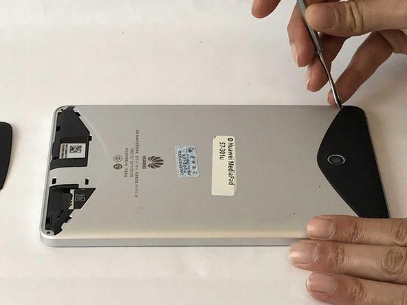 Use either your finger or a metal spudger to lift both the top and bottom black covers on the back of the tablet.