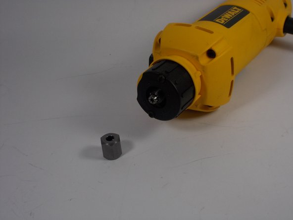 Remove the large collet nut.