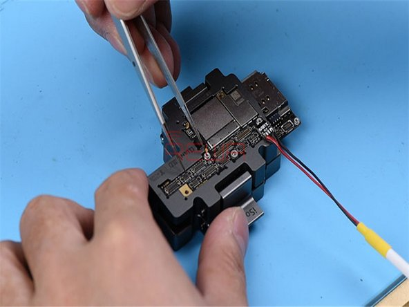 Attach the upper layer and the lower layer to the test fixture and get the phone powered on with tweezers.