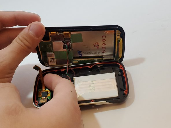 Disconnect the bronze SIM card flex cable from the motherboard with your finger.