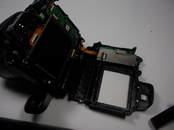 Carefully pry the face-plate away from the body of the camera, starting from the battery compartment. It should come off without too much trouble, although it may require force.