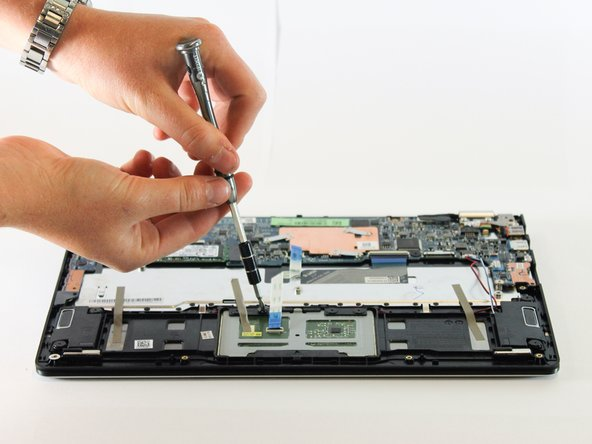 Remove the four 4mm Phillips #1 screws holding the touchpad onto the laptop.