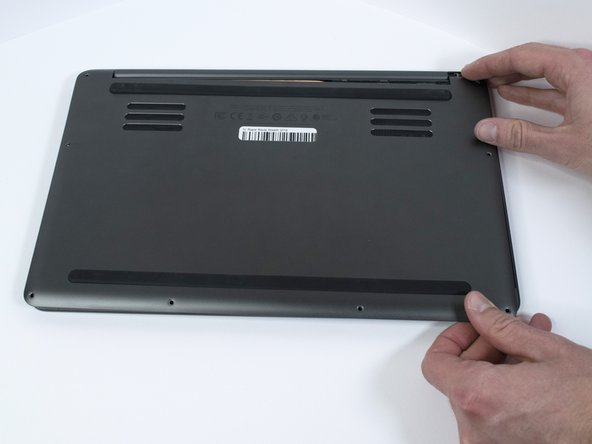 Remove the bottom cover of the laptop by sliding it away from the hinge.