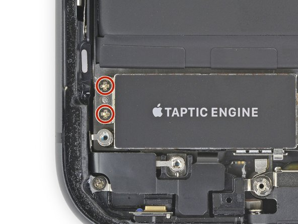 Use a Phillips driver to remove the two 1.8mm screws securing the Taptic Engine.