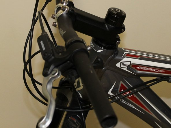 Slide the shifters back onto the handlebars so that the numbers are upright.