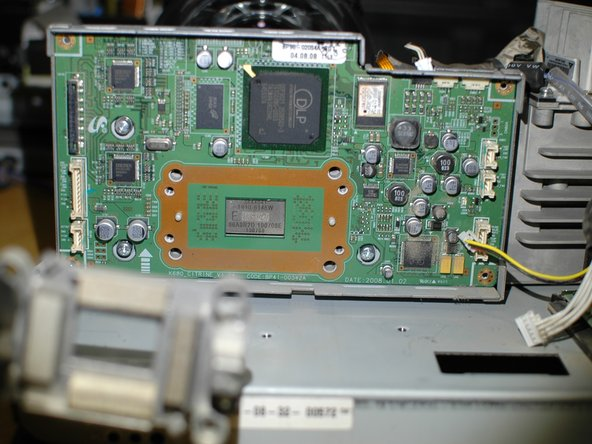 With the heatsink bracket removed the DMD board can be removed from the rear cover.