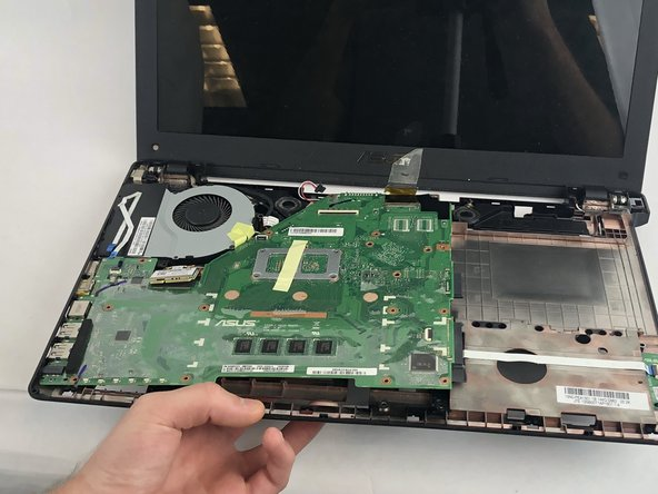 To remove the motherboard, stick your fingers through the area where the ram is inserted, lifting it up