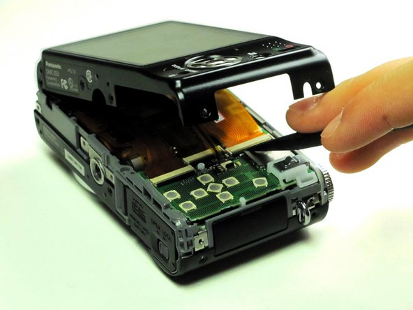 Using your fingernail or a spudger, flip up the ZIF locking flap on the two LCD ribbon cable sockets that connect the back cover to the rest of the unit.