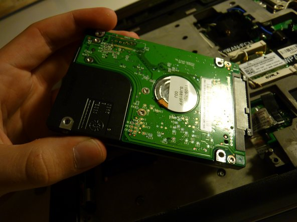 Set it aside on top of the optical drive (the metal surface)