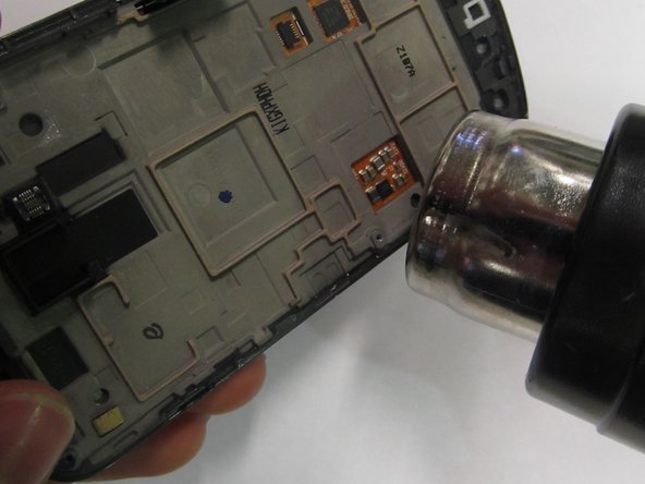 Image 1/3: Use the pry tool to pry the screen off the casing. You may need to use force to overcome the adhesive.
