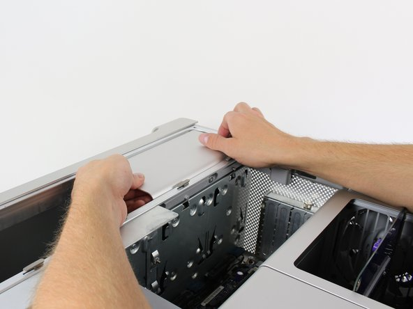 Image 1/3: Grip the handle on the left side of the power supply casing while gripping the right side of the power supply casing and pull upwards firmly to to take it out.