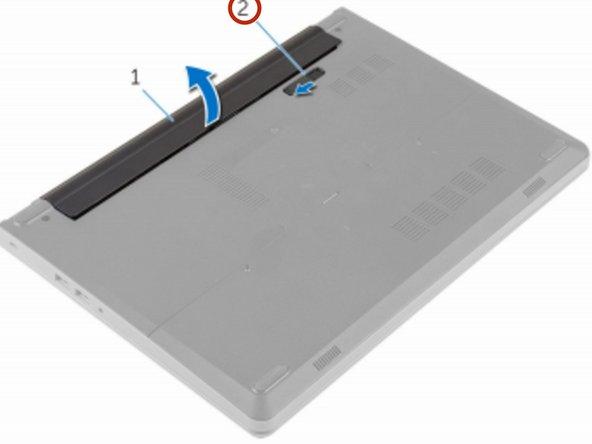 Deslice el pestillo de liberación de la batería a la posición desbloqueada.
